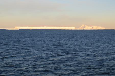 2 icebergs next to each other. Can you see the difference in their shapes?