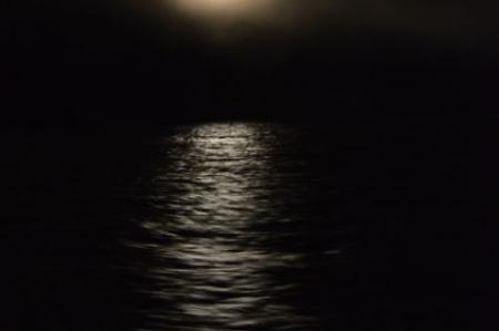 waxing gibbous moon behind the fog