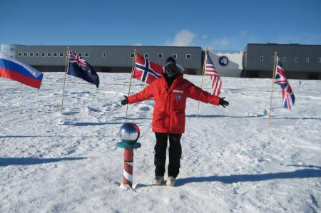 Standing at the ceremonial south pole behind the station.