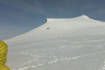 Helicopter at the Mt. Hunter Ice Divide