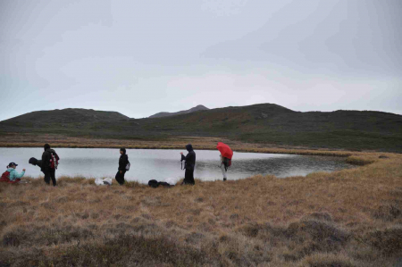 Teams atmosphere and sea tomato collect data at a lake