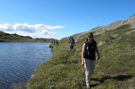 Christine leads the way along a ridgeline lake