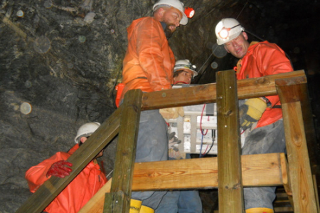 Lifting the Panel up the tunnel stairs.
