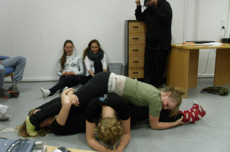 Charlotte, Fie and Cecilie playing a Danish game