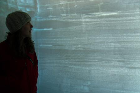 Kaitlin Keegan explaining snow layers in the backlit snowpit