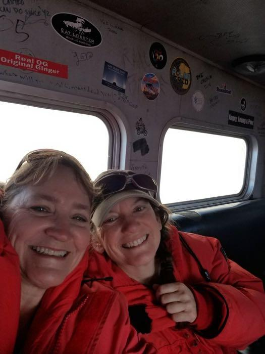 Denise and Amy on the C-130 heading home