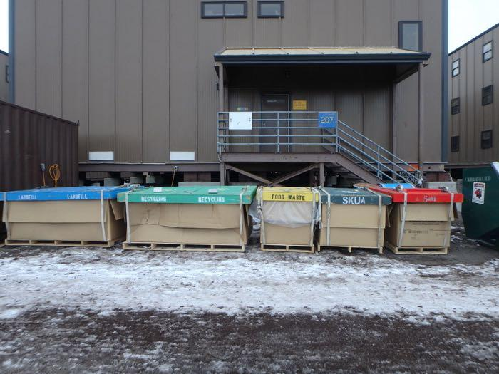 Bins labeled Landfill, Skua, recycling, food waste, and cardboard.