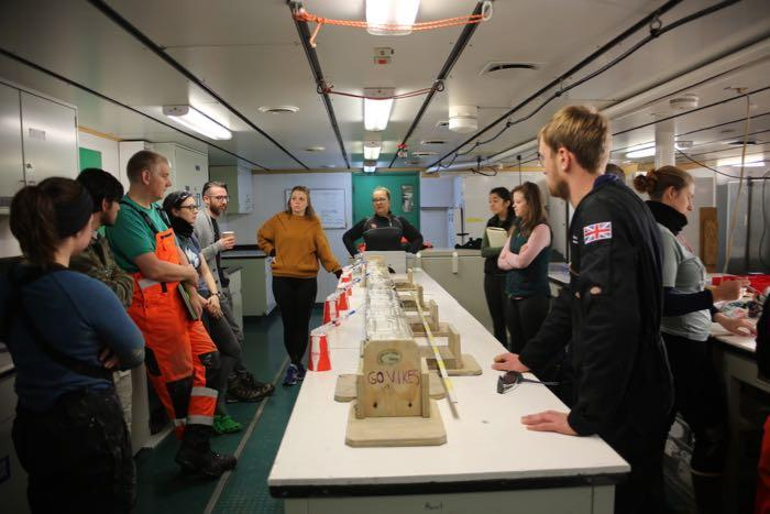 Researchers gather for a shift change meeting onboard the R/V Nathaniel B. Palmer icebreaker