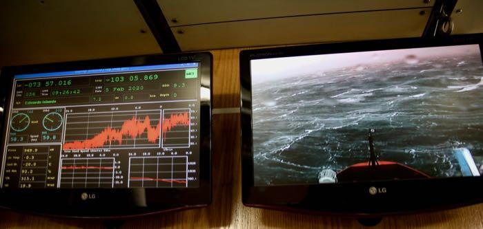 Screens showing weather conditions and the view off the bow of the R/V Nathaniel B. Palmer icebreaker