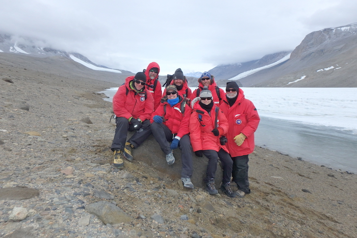 "Team ""Wormherders"" pause for a portrait at Lake Bonney, Antarctica"