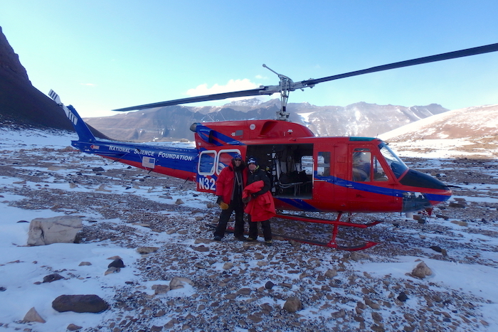 Kevin Dickerson and Dr. Byron Adams load into a Bell 212 helicopter to depart University Valley, Antarctica.