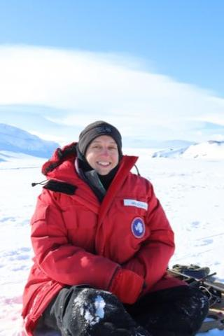 Bridget Ward sitting on the Ross Sea Ice