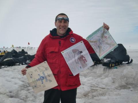 Gregg holding flags