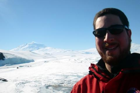 Selfie photograph with Mt. Erebus in the background.