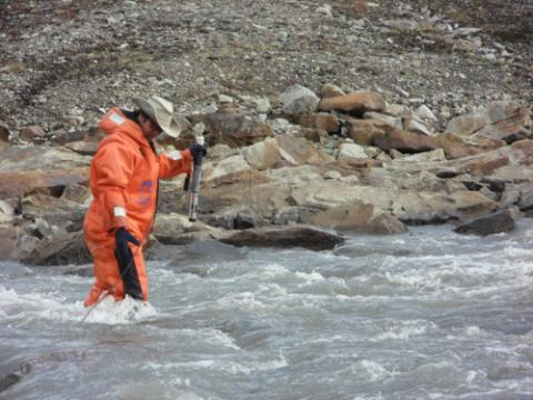 Jeremy measuring the conductivity of the glacier outlet.