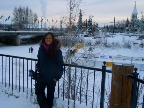 Cristina Solis standing next to the Chena River.