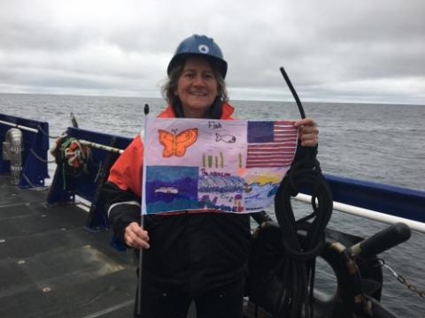 Dr. Ashjian holding an Arctic artwork flag decorated by students at the Anvil City Science Academy in Nome Alaska!  September 2, 2017.  Photo by Lisa Seff.