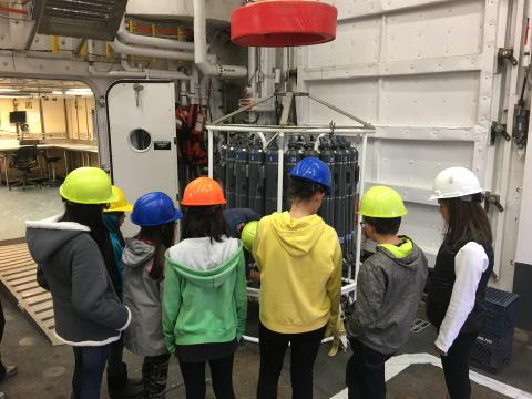 Anvil City Science Academy middle school students learn about the CTD with Dr. Okkonen and Dr. Stafford onboard the R/V Sikuliaq. Photo by Lisa Seff.  September 18, 2017.
