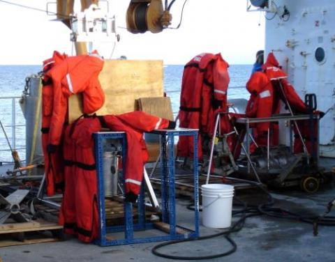 Mustang suits drying on deck after being washed.