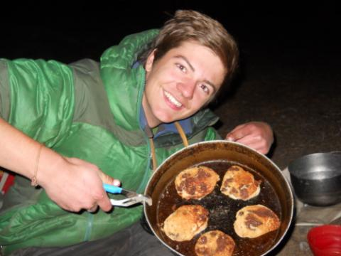 Sam Blair shows off his camp cooking skills.