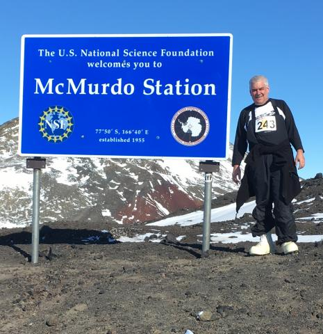 Me standing in front of the McMurdo Station sign.
