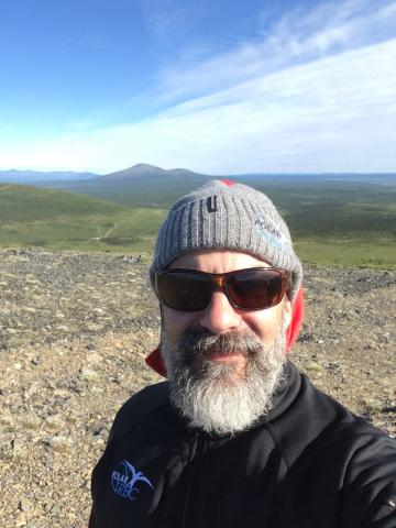 Stanley Skotnicki on top of Rodinka mountain in Cherskiy, Russia