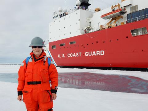 Sandi Thornton in front of USCGC Healy