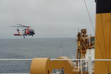 Helicopter landing on the helo deck of the USCGC Healy.