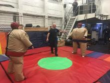 Sumo wrestling morale night in the hangar of the USCGC Healy.