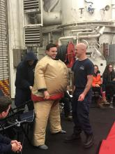 A member of the Coast guard getting into his sumo suit.