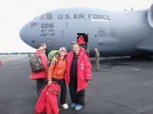 Amy Osborne and Denise Hardoy outside of C-17 airplane