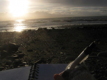 Journal, pen, and beach sunset