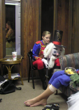 Liza in a red and blue Nutcracker outfit.