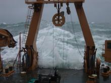 Large wave crashes over the fantail