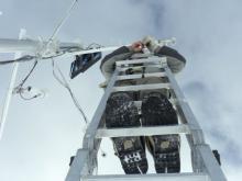 Nico on a ladder replacing the sonic sensor.