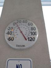 Thermometer in parking lot showing outside temperature