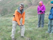 Dave Schirokauer demonstrating measuring permafrost depth
