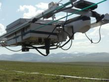 NIMS robotic sensor platform with Brooks Range in background, at Imnaviat site J