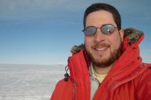 January 20, 2014: Selfie photograph at the South Pole, with the Antarctic plateau in the background.