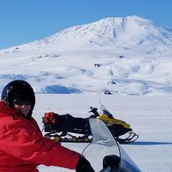 Denise Hardoy riding her Snowmobile to Cape Evans