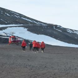 Team Walking to Helicopter