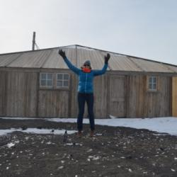 Michelle Brown in front of Discovery Hut