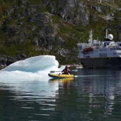 Bergy Bit, Kayaker, and NG Explorer, Skjoldungesund, Greenland