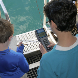 Aely and Wesley recording water column data at the side gate of NG Explorer
