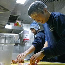 Yang Xiang and Andrew Barna Preparing Chicken