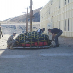 Members of the guard strapping down the pallet of luggage