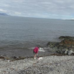 Cheryl on the beach ready for a dip.
