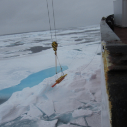 Tethered boom measuring ice thickness