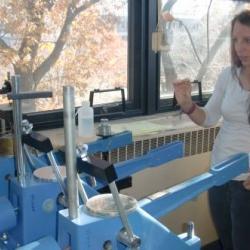 Reba explaining the consolidometer