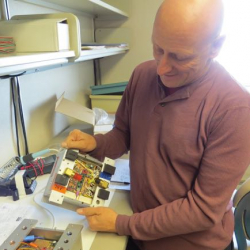 Bob Zook showing circuitry